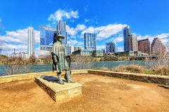Cityscapes. Skyline view of the downtown district along the Colorado River with the statue of the late Stevie Ray Vaughan cityscapes stock photo