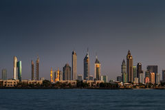 A skyline view of Dubai, UAE at Sunset as seen from Jumeirah Beach royalty free stock image