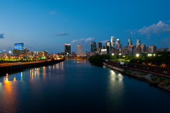 Skyline view of Philadelphia. A skyline view of Philadelphia over the Schuylkill River in Pennsylvania. The city skyline is at dusk with blue sky and blue Stock Image