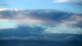 Skyline view. Photo panorama of spectacular skyline view of sea of low level cottony clouds overcast dusk on bright blue sky background, horizontal picture royalty free stock image