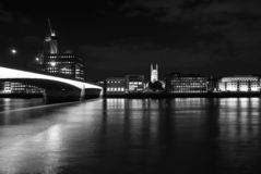 Skyline view from river on dark sky in London, United Kingdom. City and bridge with night illumination. Buildings. Reflection on water with nice architecture royalty free stock photos
