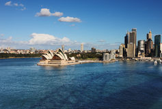 A Skyline View of the Sydney Opera House and skysc Royalty Free Stock Images