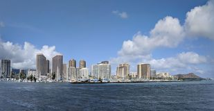 Skyline of Waikiki and Diamond Head during day with yachts and b stock image