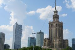 Skyline of Warsaw with business buildings and the communist Palace of Culture and Science stock photos