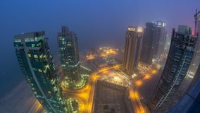 The skyline of the West Bay area from top in Doha day to night timelapse, Qatar. Skyline of the West Bay area from top in Doha day to night transition timelapse stock video