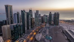 The skyline of the West Bay area from top in Doha night to day timelapse, Qatar. Skyline of the West Bay area from top in Doha night to day transition timelapse stock video footage