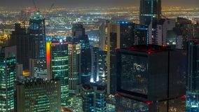 The skyline of the West Bay area from top in Doha timelapse, Qatar. Illuminated modern skyscrapers aerial view from rooftop at night stock footage