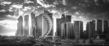 Skyline of West Bay and Doha City Center, Qatar. The skyline of West Bay and Doha City Center during sunset, Qatar . Black and white concept Royalty Free Stock Photo