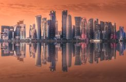 The skyline of West Bay and Doha City Center, Qatar. The skyline of West Bay and Doha City Center during sunset with reflection on water, Qatar stock photo
