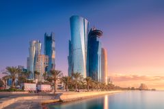 Skyline of West Bay and Doha City Center, Qatar. The skyline of West Bay and Doha City Center during sunrise, Qatar. Clipping path of sky stock images