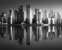 The skyline of West Bay and Doha downtown, Qatar. The skyline of West Bay and Doha City Center during sunret, Qatar . Black and white concept Royalty Free Stock Image