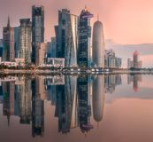 The skyline of West Bay and Doha downtown, Qatar. The skyline of West Bay and Doha City Center during sunset with gold reflection on buildings, Qatar stock photography