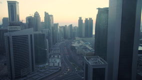 Skyline of the West Bay financial district of Doha at sunrise, Doha stock footage