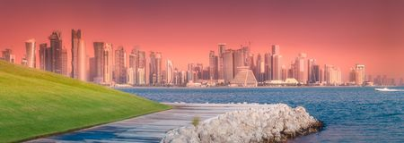 Skyline of West Bay and stony bank Doha, Qatar royalty free stock photos