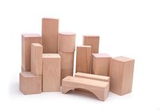 Skyline of wood city. A skyline wooden building blocks, isolated against a white background Royalty Free Stock Photo