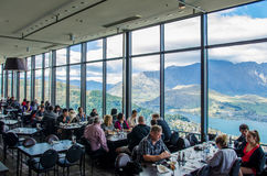 Skylines Stratosfare Restaurant & Bar, located at the top of the Gondola. Queenstown,New Zealand - April 25,2016 : People can seen enjoying their lunch and royalty free stock image