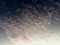 Skylines. Sunlight tainted clouds in Amsterdam Stock Photo