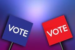 Skylten med ordet röstar på pappersblått och rött Arkivfoto