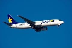 SKYMARK Fluglinien Boeing 737 am Haneda-FLUGHAFEN lizenzfreie stockfotografie