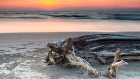 Skymning Lutong strand arkivbilder