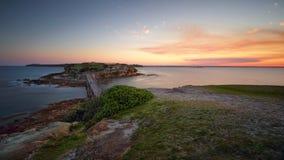 Skymningljus efter den kala ön för solnedgång Royaltyfri Bild