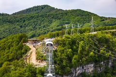 Skypark AJ Hackett Sochi, Adler, Russia - May, 2016. A metal pedestrian suspension bridge across the Mzymta River canyon in clear sunny weather against the Stock Images
