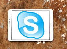 Skype logo. Skype application logo and vector on samsung tablet on wooden background Stock Image