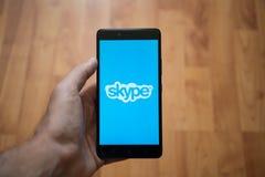 Skype logo on smartphone screen Stock Photo