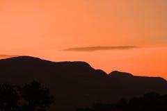 Skys alaranjados em África Fotografia de Stock Royalty Free