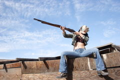 Skys the Limit. Shooting practice off the roof of an old shed Royalty Free Stock Photography