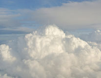 Skyscape - blue sky and thick white clouds; clouds texture. Skyscape - sky landscape with blue sky and thick white clouds seen from an airplane, dramatic look Royalty Free Stock Photography