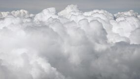 Skyscape with cloud from the plane window midair. Spectacular view from the window of an airplane. Plane flies among