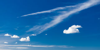Skyscape. Deep blue sky with white clouds as nature background Royalty Free Stock Images
