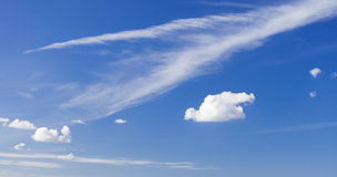 Skyscape. Deep blue sky with white clouds as nature background Stock Images