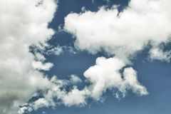 Skyscape. Deep blue sky with white clouds. Nature background. Royalty Free Stock Images