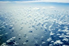 Skyscape over Indian Ocean. Beautiful skyscape over Indian Ocean. Blue sky with many single clouds below, just above ocean water Stock Image