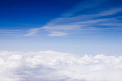 Skyscape Shot from Plane. Skyscape with blue sky and clouds, shot from airplane Royalty Free Stock Photo