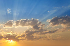 Skyscape at sunset. Sky at sunset with lots of sunbeams Stock Photography