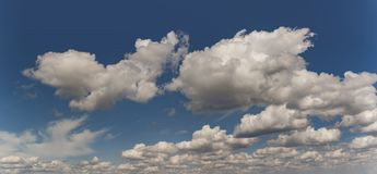Skyscape panoramic cloulds. Skyscape vista of panorama clouds in clean blue sky above the horizon Stock Image