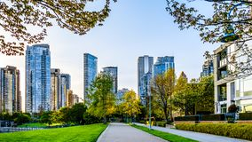 Skyscapers lining the skyline of Yaletown and David Lam Park along False Creek Inlet of Vancouver, British Columbia, Canada. Vancouver. BC/Canada-April 24, 2019 stock photography