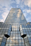 Skyscraper. Blue sky and white clouds reflection in skyscraper windows stock image
