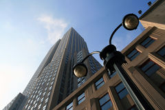 Skyscraper. A shot of a skyscraper and a street lamp in Manhattan - New York Royalty Free Stock Images