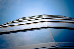 Skyscraper. Windows are reflecting deep blue sky Royalty Free Stock Photo