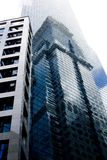 Skyscraper #7. A tall glass covered skyscraper in Singapore Royalty Free Stock Photos