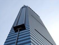 Skyscraper. Part of the skyscraper against blue sky Stock Photos