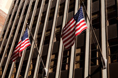 Skyscraper with American flag Stock Photo