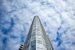 Skyscraper on a background of clouds Stock Images
