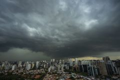 The skyscraper on the background of rainy cloud. Sao Paulo city Brazil stock photos