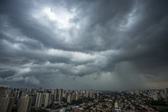 The skyscraper on the background of rainy cloud. Sao Paulo city Brazil royalty free stock photography