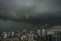 The skyscraper on the background of rainy cloud. Sao Paulo city Brazil stock photo
